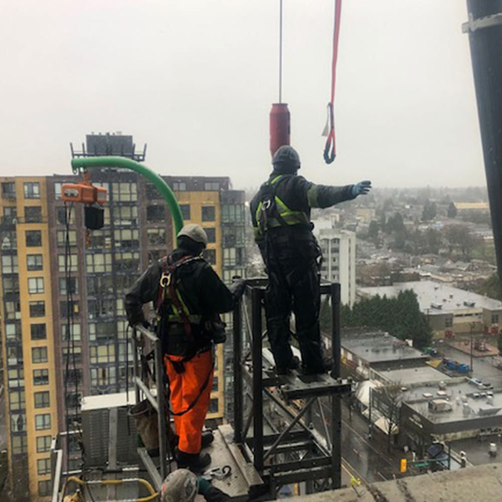 Setting tie-backs at the top of a Vancouver building